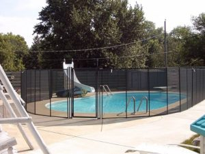 pool safety fence around in-ground pool
